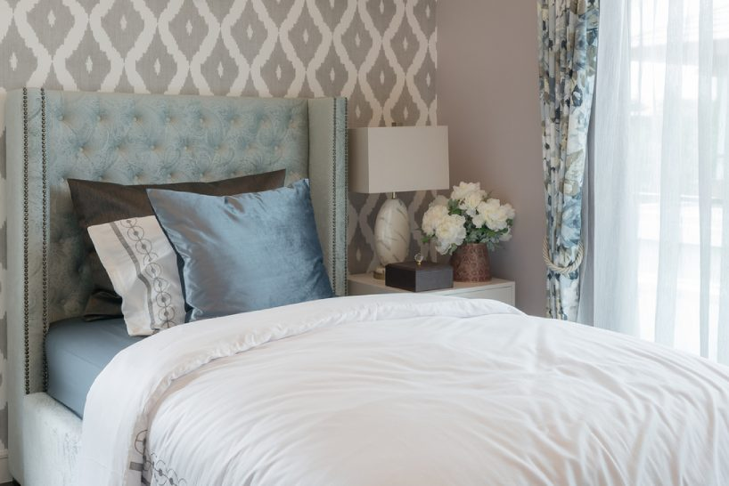 Arranging Pillow on a single bed